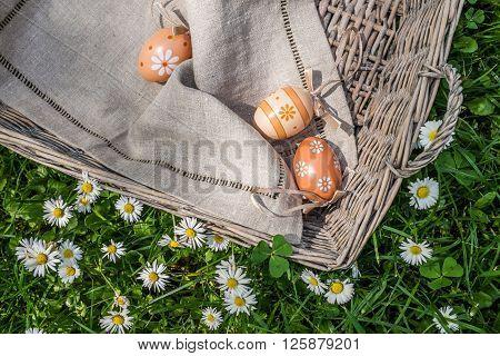 Top View Of Painted Eggs In Wicker Basket