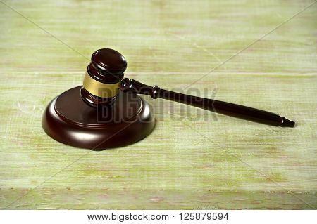 Gavel and base over wooden table
