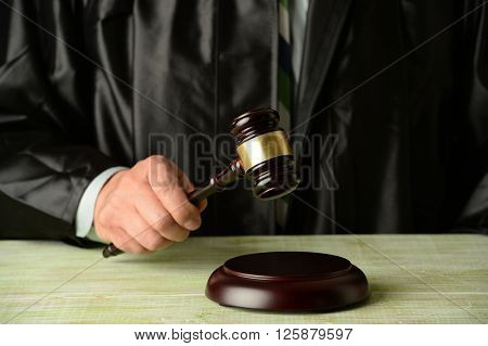 Close up of judge holding gavel