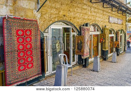 JERUSALEM ISRAEL - FEBRUARY 16 2016: The souvenir store on Via Dolorosa offers old icons and other religious goods on February 16 in Jerusalem.