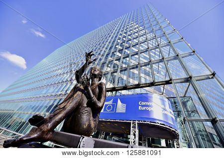 BRUSSELS BELGIUM - MARCH 16: Statue in front of the European Commission Headquarters also know as the Berlaymont building on March 16 2016 in Brussels.