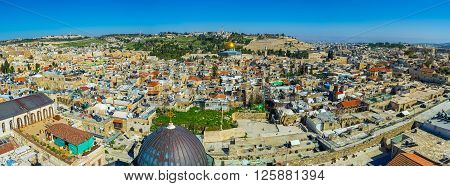 The panoramic view on the old city with the Dome of the Rock and the Mount of Olives on the background Jerusalem Israel.