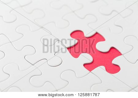 Puzzle with missing part on red background