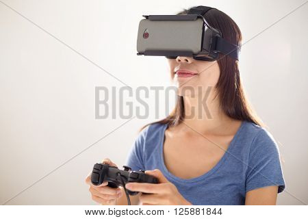 Woman wearing VR device with joystick