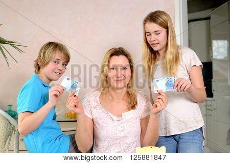 Mother Giving Her Children Pocket Money