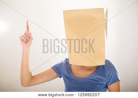Woman with paper bag cover her head and finger point up