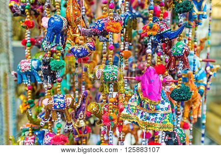 The wind chimes with elephants camels and parrots are the traditional Eastern decoration and popular tourist souvenir Jerusalem Israel.