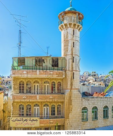 JERUSALEM, ISRAEL - FEBRUARY 18, 2016: The white mosque with the high minaret located opposite the Austrian Hospice in the Muslim Quarter , on February 18 in Jerusalem.