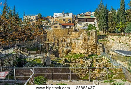 The archaeological site of Bethesda pool is the place visited by tourists and pilgrims who comes to St Anne's Church in Via Dolorosa Jerusalem Israel.