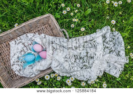 Easter Eggs In Basket On Green Grass, Top View