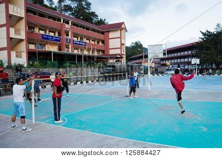 TANAH RATA, MALAYSIA - CIRCA FEBRUARY, 2015: Young guys playing in game Sepak Takraw in the Cameron Highlands. Sepak Takraw very popular sports game in the countries of Southeast Asia.