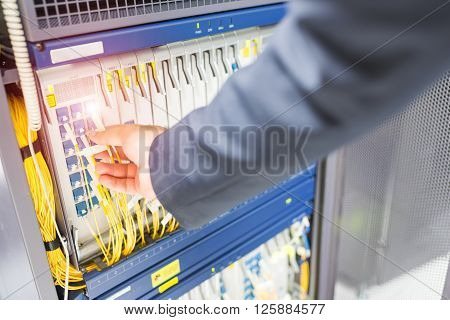 People Fix Core Switch In Network Room