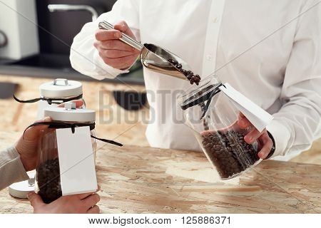Coffee shop. Salesman packing coffee beans .