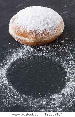 donut with marmalade on a black background