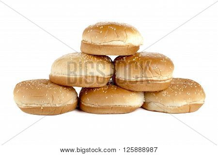 A Group Of Burger Buns With Sesame Seeds