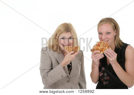 Two Business Women Eating Pizza