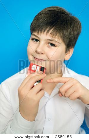 A funny teenage boy with a bank card
