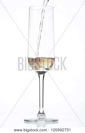 Champagne Being Poured Into An Empty Glass