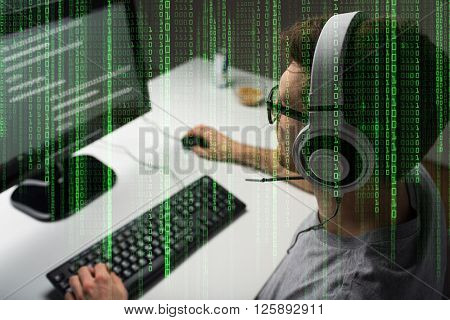 technology, gaming, entertainment, let's play and people concept - close up of young man in headset and glasses with pc computer playing game at home and streaming playthrough or walkthrough video