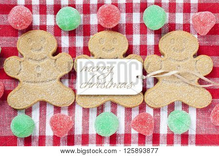 Close Up Image Of Gingerbread Candies With Merry Christmas Tag