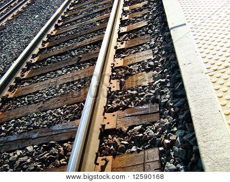 Train track trough station close up