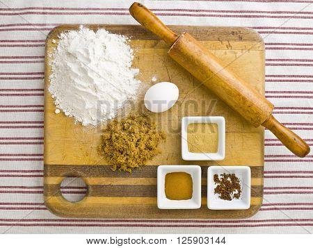 Image Of Rolling Pin With Cake Ingredients On A Wooden Cutting Board