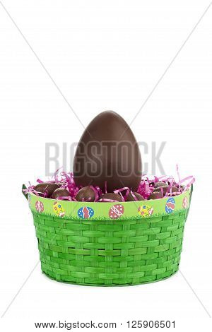 One Big Brown Easter Egg In Green Basket