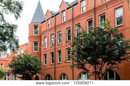 Old Red Brick Building with Turret Windows in Savannah