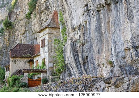 Saulieu, France, June 20, 2015 : Cave Dwelling Houses In The Cliff Of The Cele Valley, In The Old Vi