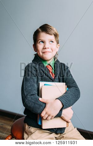 childhood, school, education and people concept - happy smiling student boy with books