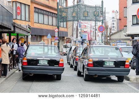 TOKYO, JAPAN-MARCH 30: Taxi waiting area near the kamakura station in Tokyo on MARCH 30, 2016 in Tokyo,Several taxi cabs are waiting in line along the sidewalk.