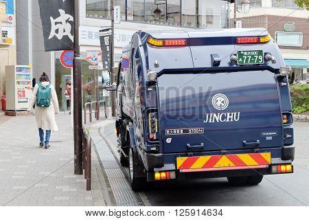 TOKYO, JAPAN -MARCHL 30 2016: Garbage truck on kamakura street on MARCH 30, 2016 in Tokyo,Japan