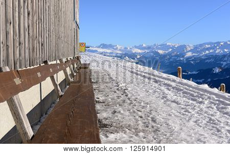View from the Rigi Kulm in winter with wooden bench for taking view Lucerne Switzerland