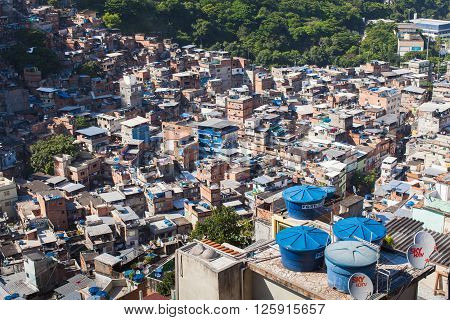 RIO DE JANEIRO BRAZIL - DEC 27 2013: Rocinha is the largest favela in Brazi. About 80000 people live in Rocinha making it the most populous favela in Rio de Janeiro.