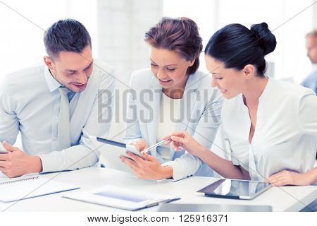 smiling business team working with tablet pcs in office