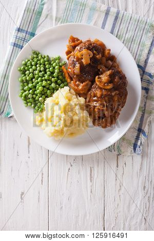 Salisbury Steak With Gravy, Mashed Potatoes And Green Peas. Vertical Top View