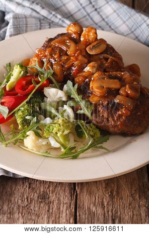 Salisbury Steak With Mushroom Sauce And Vegetables Close-up. Vertical