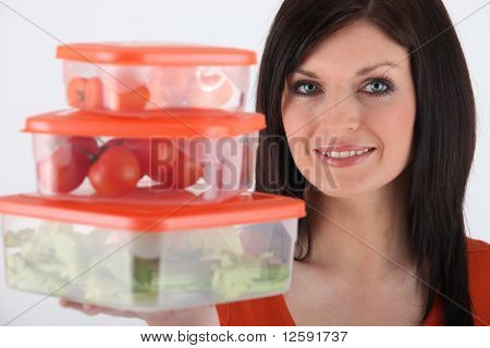 Young woman with airtight boxes