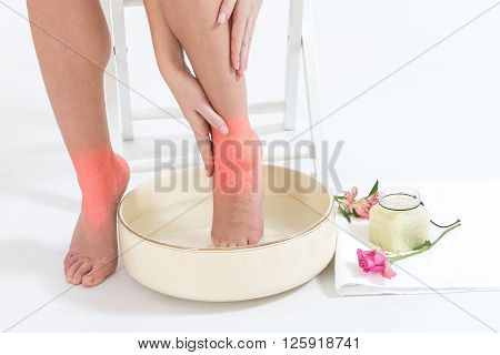 relaxation with a foot bath for woman fo woman' legs ankle pain