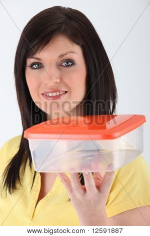 Young woman with an airtight box