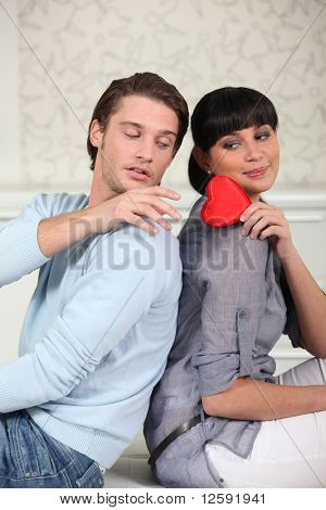 Young woman offering her heart to a man
