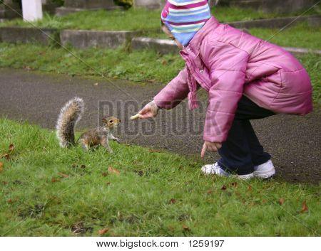 Girl Feeding Squirrel