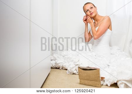 Beautiful bride getting ready for her wedding day
