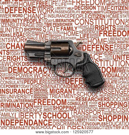 Revolver Gun toy for children with background concept wordcloud of human rights