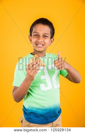 indian kid eating sandwich, asian boy and sandwich, indian boy showing sandwich, cute african boy showing sandwich on yellow background