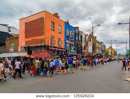 LONDON UK - 19TH JULY 2015: Large amounts of people along Camden High Street during the day on a weekend
