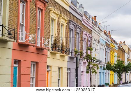 LONDON UK - 20TH JULY 2015: Colorful buildings along Hartland Road in Camden during the day.