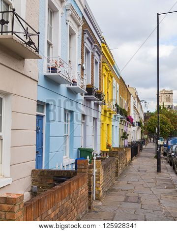 LONDON UK - 20TH JULY 2015: Colorful buildings along Hardland Road in Camden during the day.