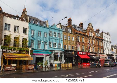 LONDON UK - 26TH MARCH 2015: A view of various restaurants and businesses along Upper Street in Islington london. People can be seen.