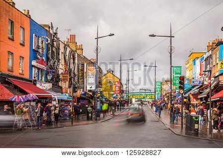 LONDON UK - 26TH MARCH 2015: Camden Town during the day showing buildings business and the blur of people and traffic